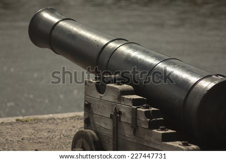 antique cannon that protects the entrance to the harbor of the island before the Kronstadt St. Petersburg, Russia