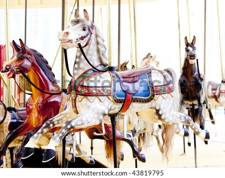 antique carousel horses - stock photo