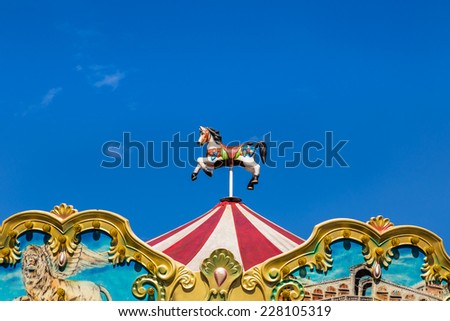 antique carousel in amusement park - stock photo
