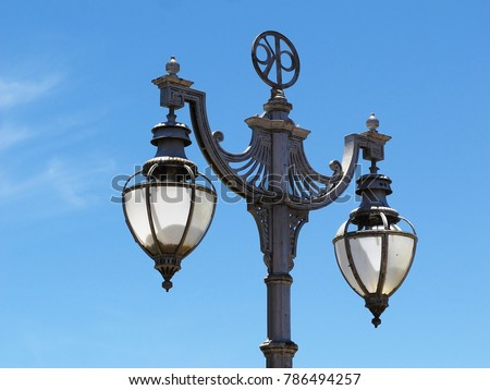 Antique cast iron street light post stock photo royalty free antique cast iron street light post in historical part of kimberley the first electric streetlights mozeypictures Choice Image