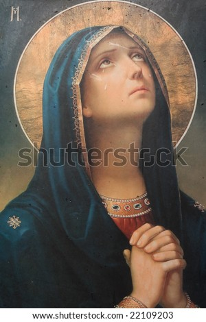 antique catholic icon representing virgin mary praying - stock photo