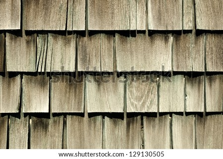 Antique cedar siding on a vintage 1940 barracks at an deserted airbase - stock photo