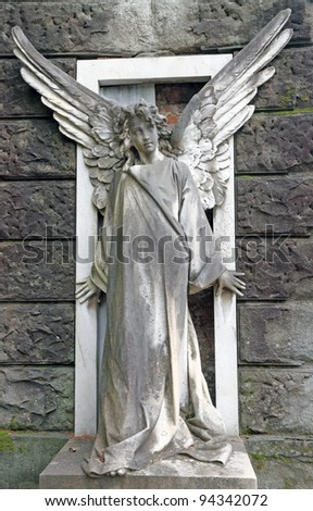 antique cemetery angel on monumental cemetery in Florence, Italy, Europe - stock photo