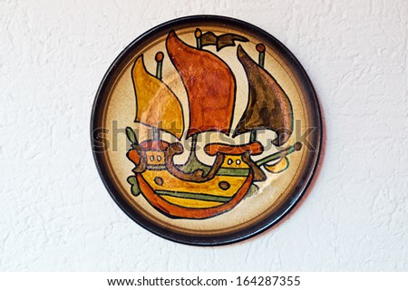 Antique ceramic plate located at Cyclades islands, Greece - stock photo