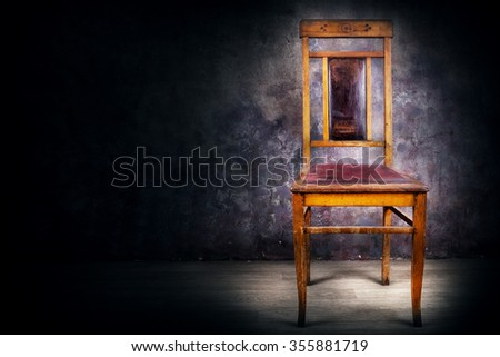 Antique chair with back on grange background
