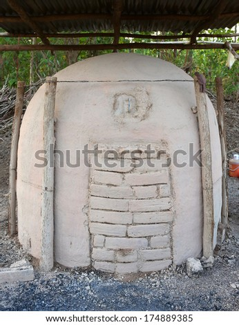 antique charcoal clay oven - stock photo