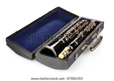 Antique clarinet in case isolated on white - stock photo