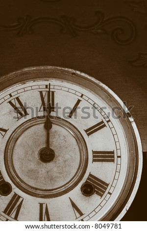 Antique Clock Face in sepia tone.