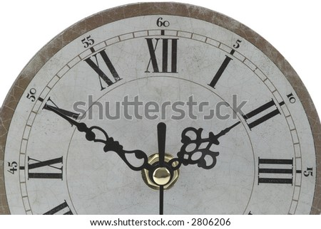 Antique clock face on a white background.