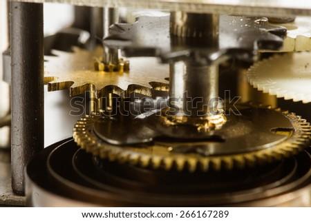 Antique clock gears - stock photo