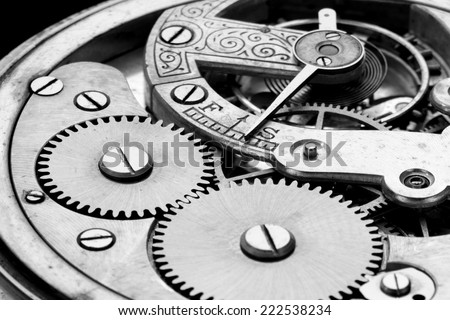Antique clock machinery black and white photo
