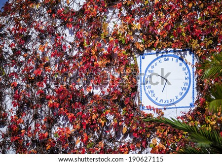 Antique clock on a building. - stock photo
