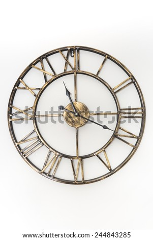 Antique clock on the wall - stock photo