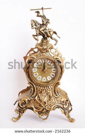 Antique clock showing midnight time - stock photo