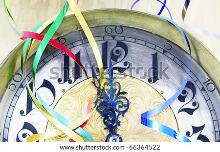 Antique clock with New Year ribbons - stock photo