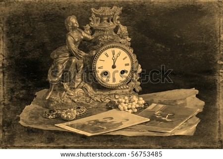 Antique clocks, jewelry and photographs on a dark background, stylized antique photos - stock photo