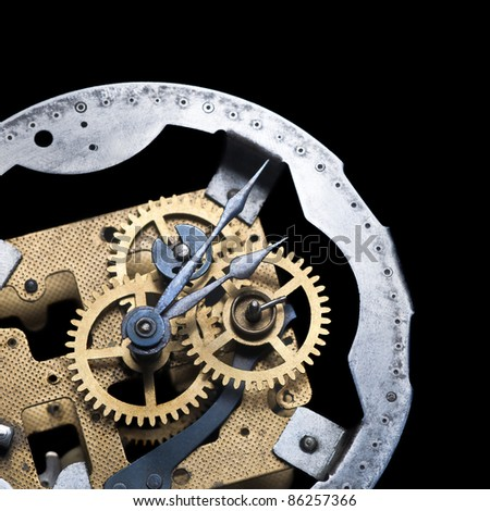 antique clockwork isolated on black - stock photo