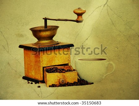Antique coffee grinder with coffee beans an cup of hot black coffee - stock photo