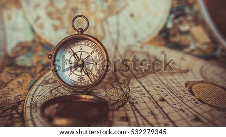 Antique compass and old world map. (vintage style)