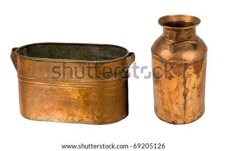 antique copper pan and jug on a white background
