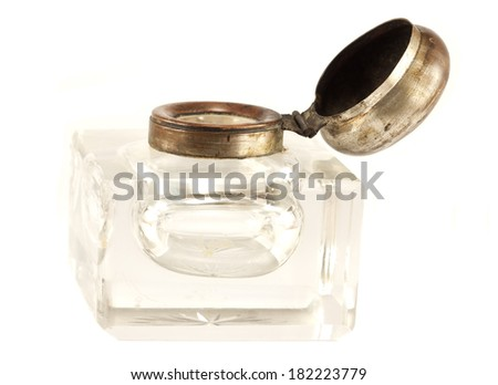 Antique crystal inkwell on a white background - stock photo