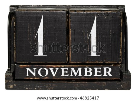 Antique cube calendar showing November 11 - Veterans Day, isolated on a white background - stock photo