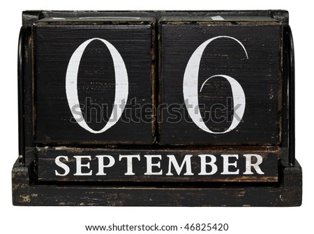 Antique cube calendar showing September 6 - Labor Day, isolated on a white background - stock photo