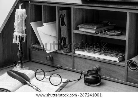 Antique desk with his pen and old books - stock photo