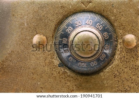 Antique dial combination lock close up. Black dial and gold plate.  - stock photo