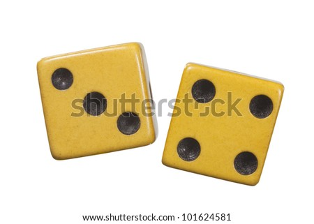 Antique dice with aged yellow patina macro isolated on white.