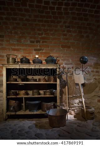 Antique dishes in a dark cellar - stock photo