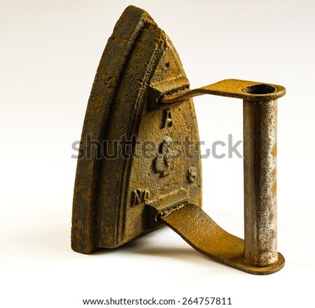 Antique domestic flat iron in upright position isolated on white background - stock photo