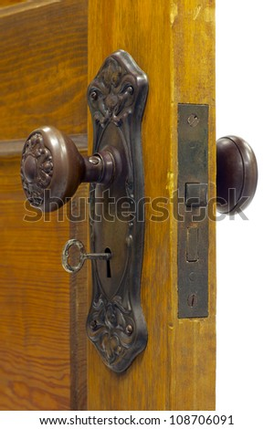 Antique door and door handle with skeleton key in the keyhole