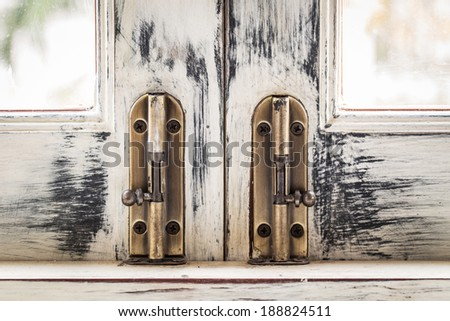 Antique door and door lock - stock photo