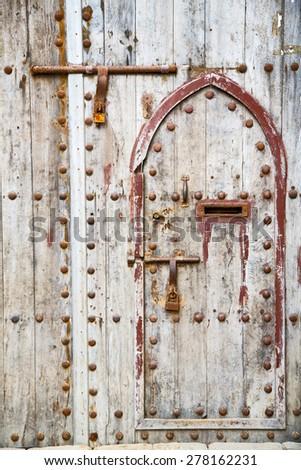 antique door in morocco africa blue wood and metal rusty - stock photo