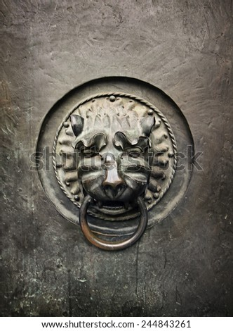 Antique door knocker in the form of a lion's head on old metal door of Lutheran Church St. Lorenz, Nuremberg