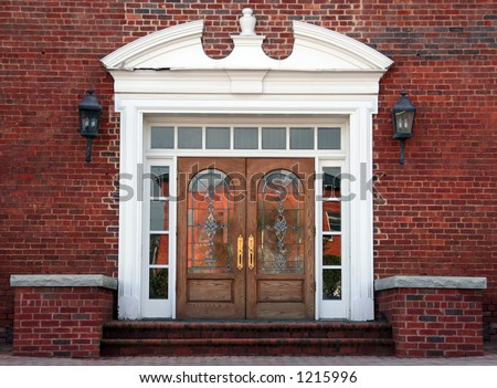 Antique double leaded glass doors on a brick building - stock photo