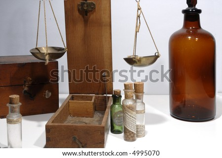 antique drugstore bottles and weighing scales - stock photo
