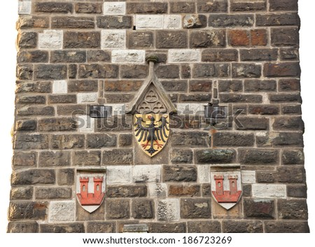 Antique eagles emblem on the wall of old tower in Rothenburg od der Tauber. - stock photo