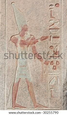 Antique egyptian carved wall with pharaoh and hieroglyphs in Luxor, Egypt