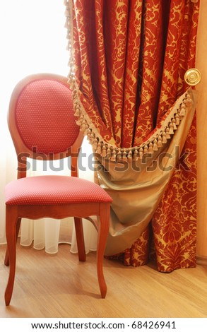 antique elegance chair and curtain with tassels - stock photo