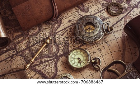 Antique engraved watch on ancient world stock photo safe to use antique engraved watch on ancient world map gumiabroncs Image collections
