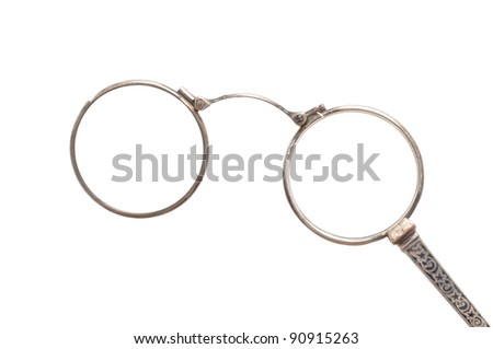Antique eyeglasses in front of a white background