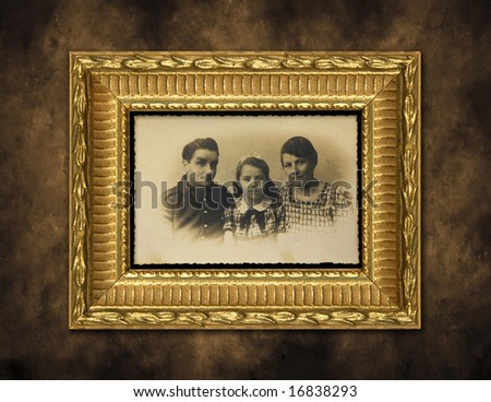 Antique Family Photo Framed on a Grunge Distressed Background