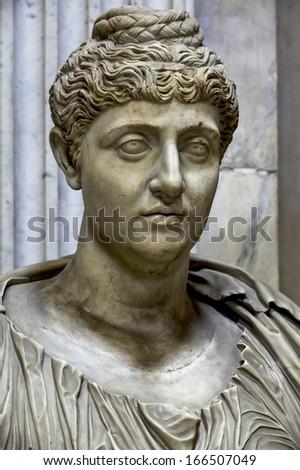 Antique feminine face of the statue in the Vatican Museum  - stock photo