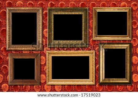 Antique frame collection on luxurious red velvet wall. Add your own images. - stock photo