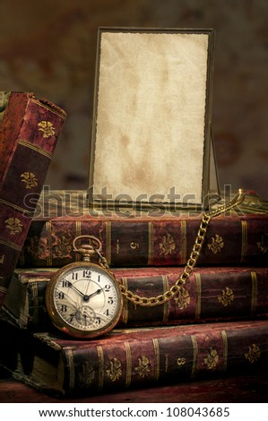 Antique Frame with old photo paper texture, Books and Pocket Clock. - stock photo