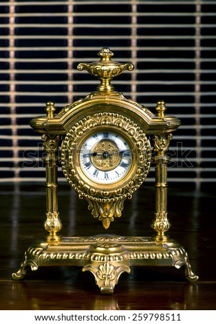 Antique French gold clock. - stock photo