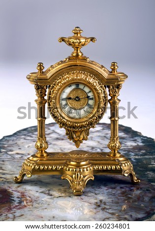 Antique French gold clock made in the late 1800's. - stock photo