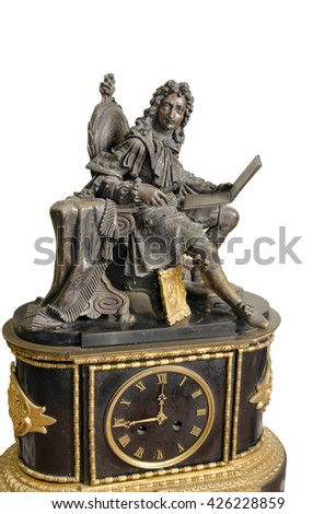 antique French mantel clock and statuette of King, 18th century - stock photo